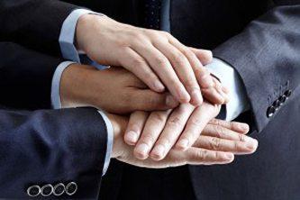 businessmen putting hands together