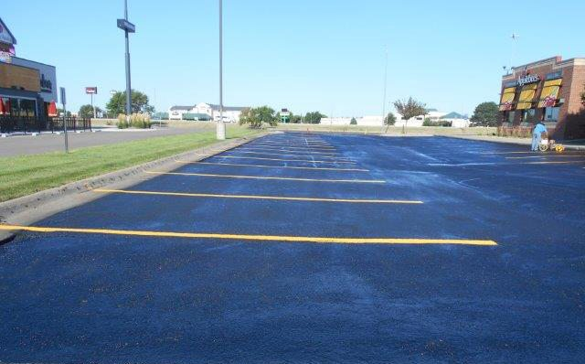 resurfaced and restriped applebees parking lot