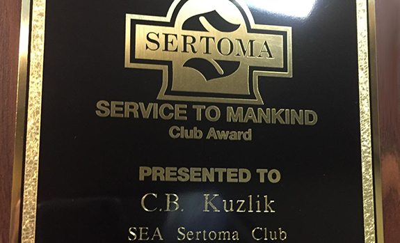 close up of CB Kuzlik's SEA Sertoma Club Award