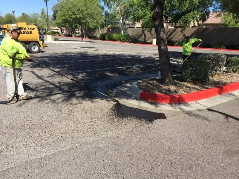 kohls parking lot sealer in progress