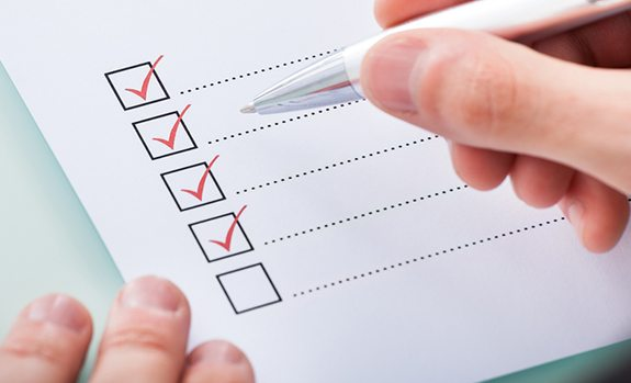 man checking boxes on checklist