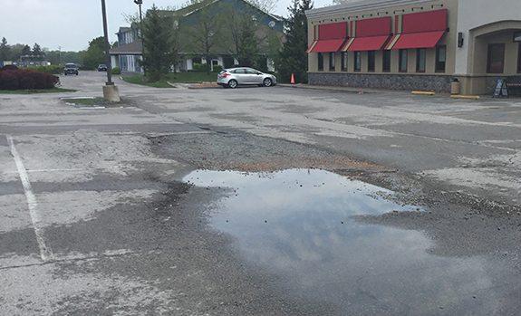 major potholes in parking lot