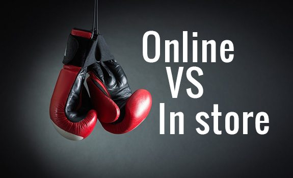 Online Vs In Store with boxing gloves