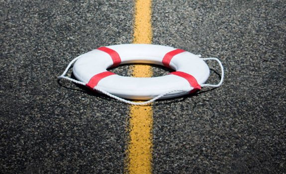 lifebuoy on pavement