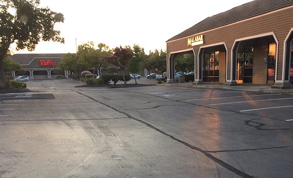 crack in store's parking lot pavement