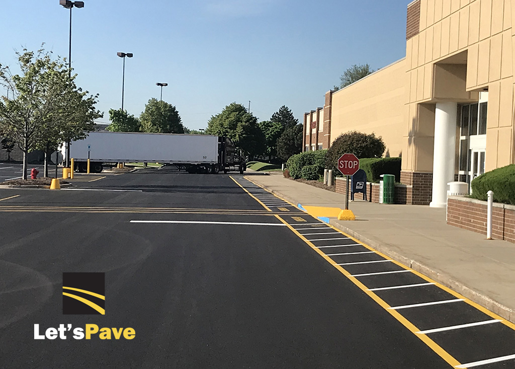 finished entrance of store parking lot after repair