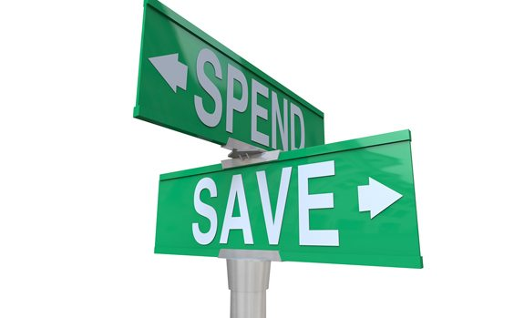 sign directions pointing to spend or save