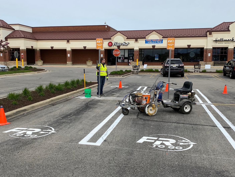gentleman installing curbside parking in parking lot