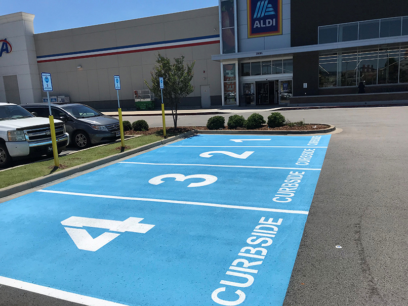 four parking spots in parking lot blue for curbside