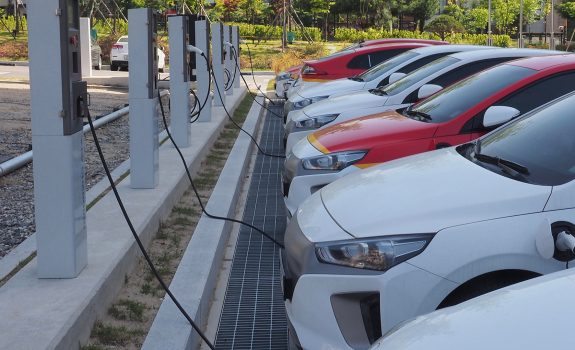 multiple cars lined up at charging station in Korea