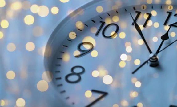 close-up of clock 5 minutes till 12