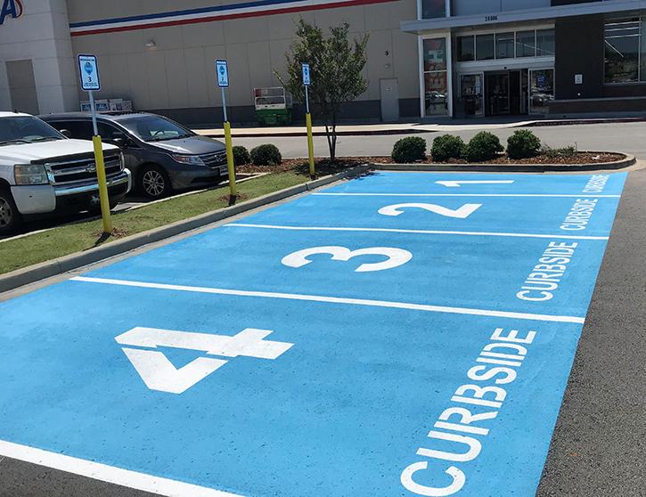 4 freshly painted curbside parking spots